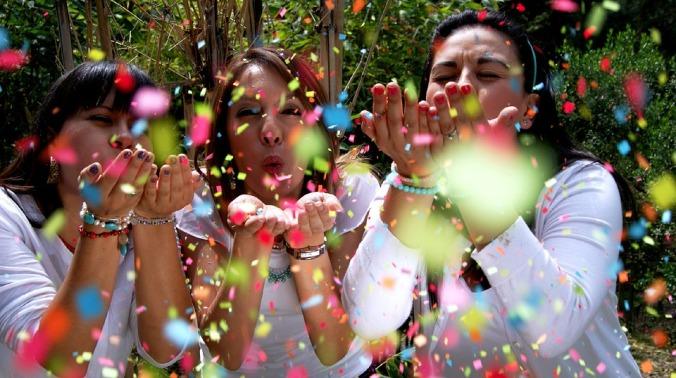 friends blowing confetti.jpg