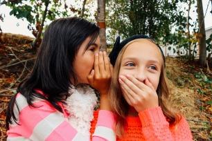 friends whispering